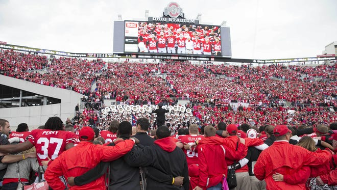 """The Ohio State Buckeyes sing """"Carmen Ohio"""" with their fans after defeating Purdue at Ohio Stadium Oct. 20."""