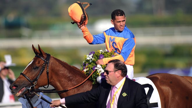 Javier Castellano, aboard Zagora led by trainer Chad C. Brown, celebrates after winning race eight during the 2012 Breeders' Cup at Santa Anita Park.