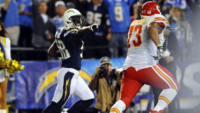 Chargers linebacker Demorrio Williams (58) returns an interception for a touchdown during the fourth quarter against the Chiefs at Qualcomm Stadium.