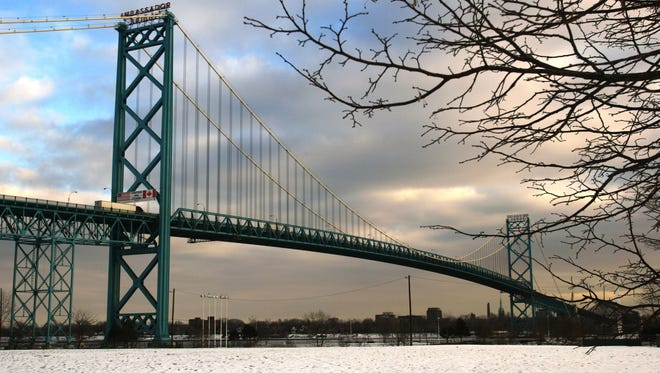 Thousands of trucks each day cross the Ambassador Bridge, which links Detroit to Windsor, Ontario. File