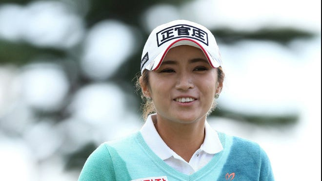 Lee Bo-Mee of South Korea smiles after scoring a bogey-free 8-under 64 in the second round of the Mizuno Classic.