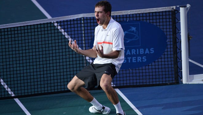 Jerzy Janowicz of Poland celebrates his victory Saturday against Gilles Simon of France, sending him to the Paris Masters final.