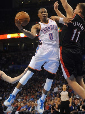 Oklahoma City Thunder point guard Russell Westbrook (0) takes a shot against Portland Trail Blazers center Meyers Leonard during the second half at Chesapeake Energy Arena.