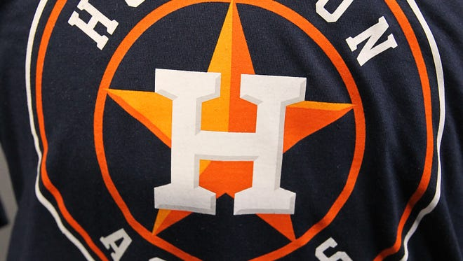 The new Houston Astros logo is displayed on a T-shirt at Minute Maid Park on Friday.