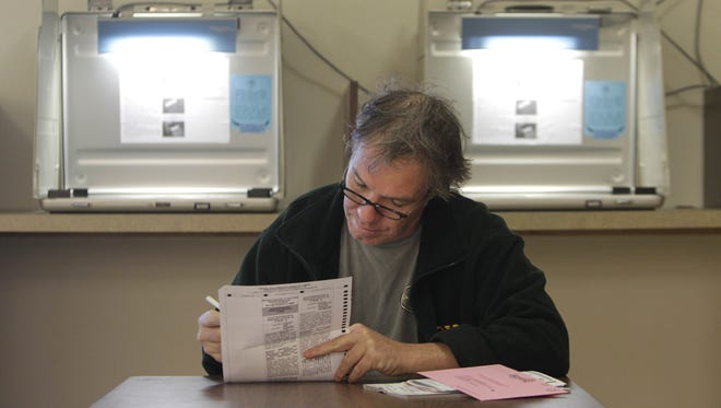 California resident Martin Fray marks his ballot while voting early at the Sacramento County Registrar of Voters office. On Nov. 7, voters will face a number of proposed tax measures.