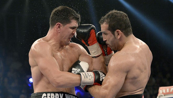 German WBO world cruiserweight champion Marco Huck, left, and compatriot Firat Arslan fight during their title bout. Huck successfully retained the WBO title for the 10th time with a unanimous decision win over Arslan.