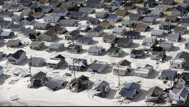 Sand fills the streets along the central Jersey shore in the wake of superstorm Sandy.