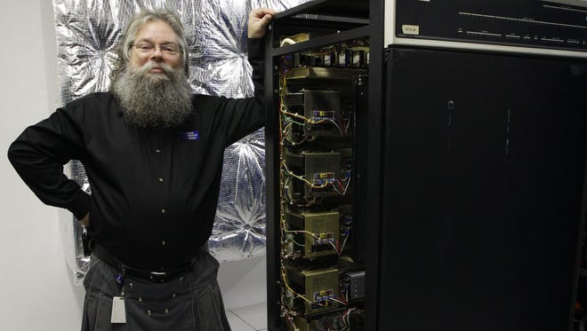 Ian King, senior vintage systems engineer at the Living Computer Museum in Seattle, stands by a memory module of a DEC PDP-10 computer from the early 1970s that holds 16 kilobytes of computer memory.