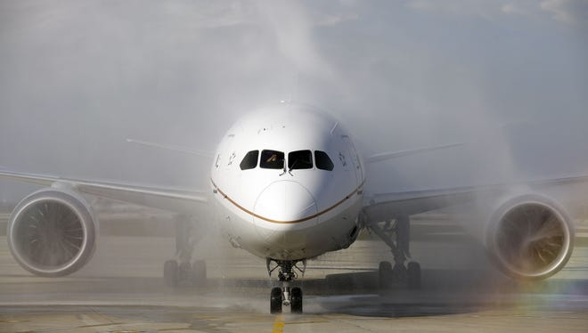 A United Airlines 787 Dreamliner receives a ceremonial water-cannon salute as it arrives at O'Hare International Airport in Chicago on Nov. 4, 2012. The flight from Houston was United's inaugural 787 revenue flight.