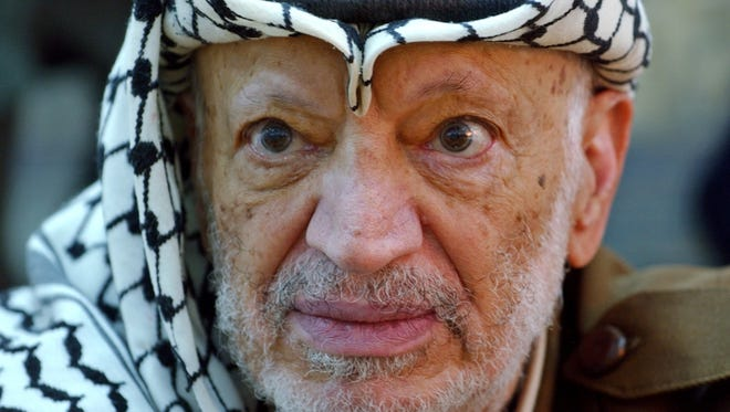 Palestinian leader Yasser Arafat pauses during an emergency cabinet session in the West Bank town of Ramallah on Oct. 2, 2004.