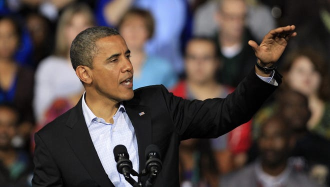 President Obama speaks at a campaign event at Nationwide Arena Monday in Columbus, Ohio.