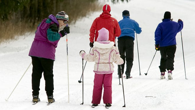 Exercise is one of the reasons many people take up the family friendly activity of cross-country skiing.
