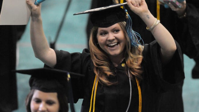 A graduate celebrates during commencement at the University of North Carolina at Wilmington on May 12.