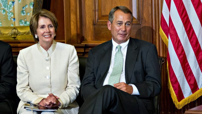 House Minority Leader Nancy Pelosi of Calif. and House Speaker John Boehner of Ohio sit together during a ceremony in July to award the Congressional Gold Medal posthumously to Constantino Brumidi in recognition of his artistic contributions to the U.S. Capitol building.