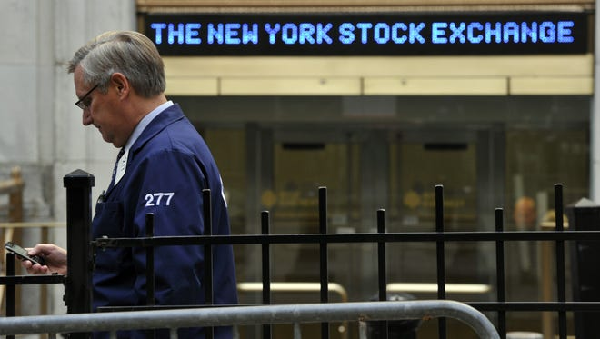 A trader outside the New York Stock Exchange.