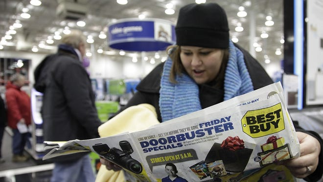 Retailers lure shoppers into stores on the Friday after Thanksgiving with bargains and doorbuster specials.