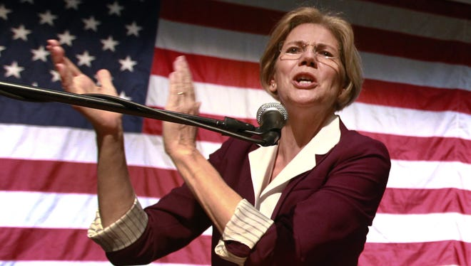 Elizabeth Warren addresses an audience during a campaign rally at a high school in Braintree, Mass., Nov. 4.
