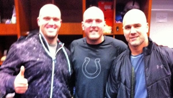 Colts players (from left) Matt Overton, Pat McAfee and Adam Vinatieri show their support for head coach Chuck Pagano.