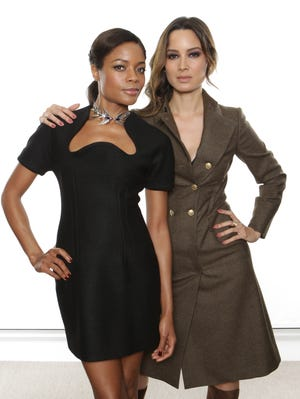 Naomie Harris, left, and  Berenice Marlohe star in the new James Bond film, 'Skyfall,' out Friday.