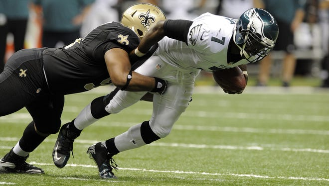 New Orleans Saints defensive end Will Smith (91) sacks Philadelphia Eagles quarterback Michael Vick (7) for a loss during third quarter of their game at the Mercedes-Benz Superdome.
