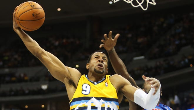 Denver Nuggets guard Andre Iguodala dunks the ball during the second half against the Detroit Pistons at the Pepsi Center.