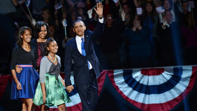 President Obama and family arrive on stage in Chicago after winning the 2012 U.S. presidential election.