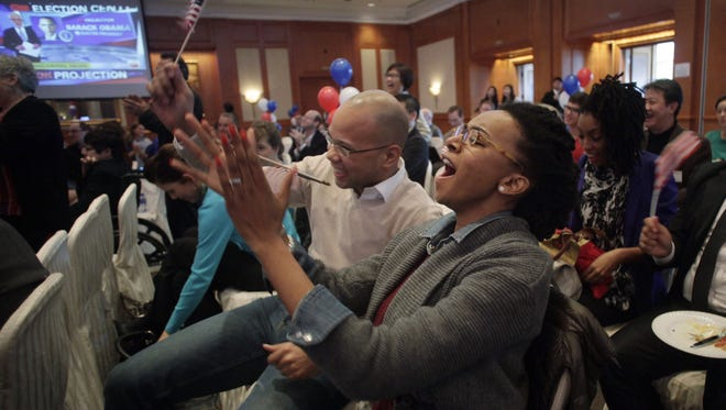 Guests react as they watch live TV coverage showing the re-election victory of President Obama Wednesday in Shanghai.