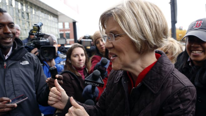 Massachusetts Senator-elect Elizabeth Warren, D-Mass., gives two thumbs up as she arrives to greet commuters and thank Massachusetts residents, Nov. 7, 2012, in Boston.