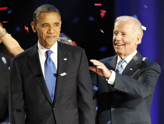 President Obama and Vice President Joe Biden celebrate on Nov. 7 at McCormick Place in Chicago. President Obama defeated Republican challenger Mitt Romney in the 2012 presidential election.