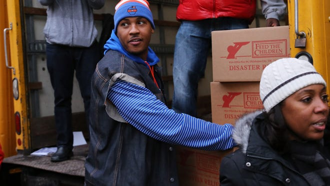 Knicks star Carmelo Anthony returned Thursday to Brooklyn to hand out boxes for Sandy relief.