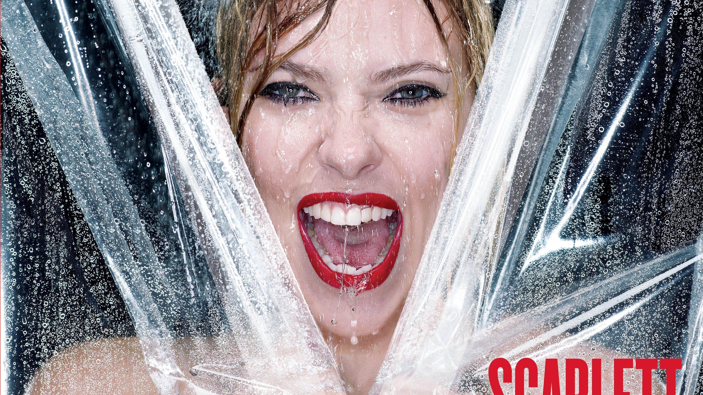 Scarlett Johansson gets wet, reveals new tattoo