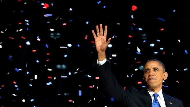 President Obama waves to supporters after his victory speech at McCormick Place on election night 2012 in Chicago