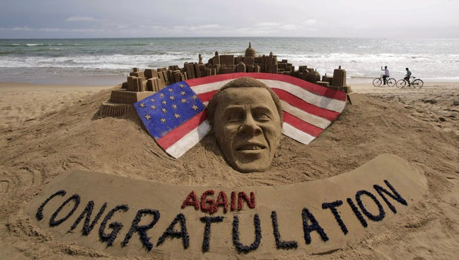 A sand sculpture congratulating U.S. president Barack Obama for a second term in office in Puri, India.