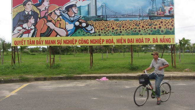 A Communist Party propaganda sign in central Vietnam's Danang City reads 'Determined to push forward the modernization and industrialization of Danang City.'
