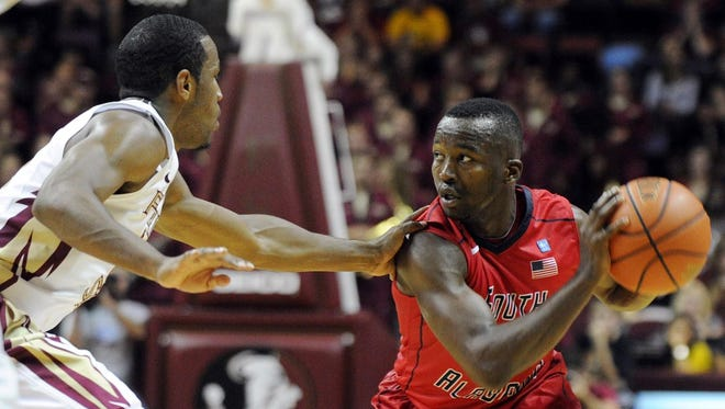 South Alabama Jaguars guard  Xavier Roberson looks to pass the ball past Florida State Seminoles guard Michael Snaer during the game against the South Alabama Jaguars at the Donald L. Tucker Center.