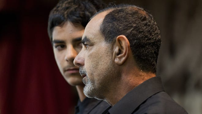 Kassim Alhimidi, right, speaks alongside his son, Mohammed Alhimidi, during a memorial for his wife, Shaima Alawadi, at a mosque in Lakeside, Calif., March 27, 2012.