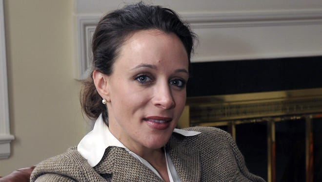 "In this Jan. 15, 2012 photo, Paula Broadwell, author of the David Petraeus biography ""All In,"" poses for photos in Charlotte, N.C."