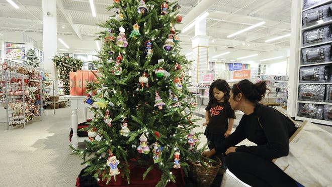 Samantha Alrafe and her daughter Aida  look over Christmas displays at a JC Penny in Glendale, Calif..