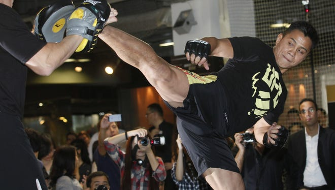 Former Strikeforce middleweight champion Cung Le, a Vietnamese-American, demonstrates his skill during a pre-fight press conference this week.