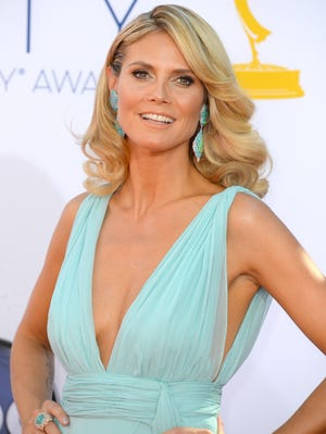 Heidi Klum arrived solo to this year's Emmys.