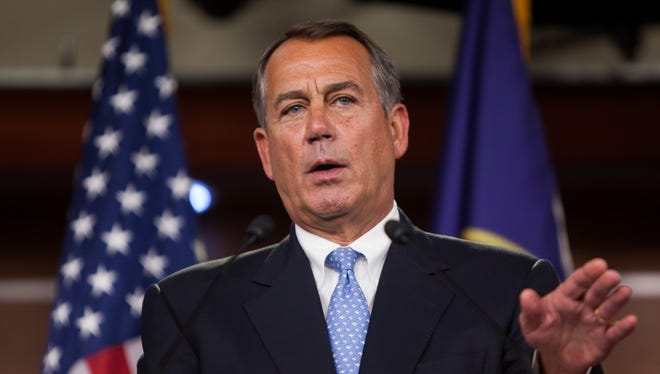 Speaker of the House Rep. John Boehner addresses the media during a press conference in the U.S. Capitol building Friday.