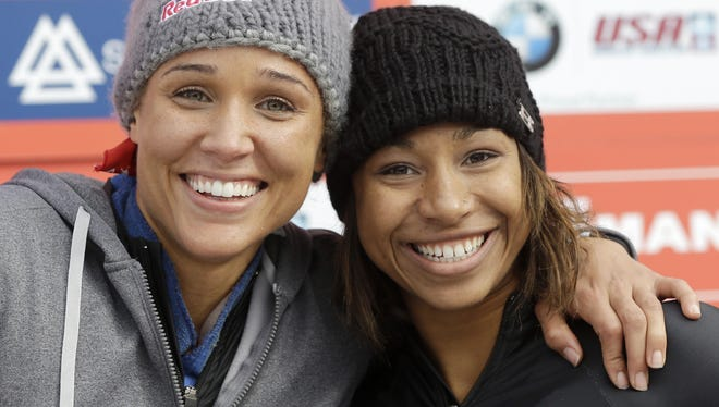 USA's pilot Jazmine Fenlator, right, and brakewoman Lolo Jones pose for photographers after their second-place finish in the women's bobsled World Cup competition on Friday in Lake Placid, N.Y.