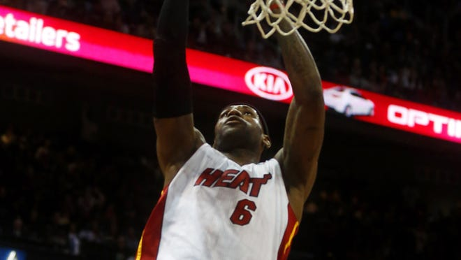 Heat forward LeBron James (6) goes for a dunk during the first half at Philips Arena.