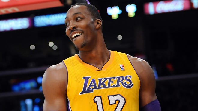 Lakers center Dwight Howard smiles after he was given a foul in the first half of a game against the Warriors at Staples Center on Nov. 9.