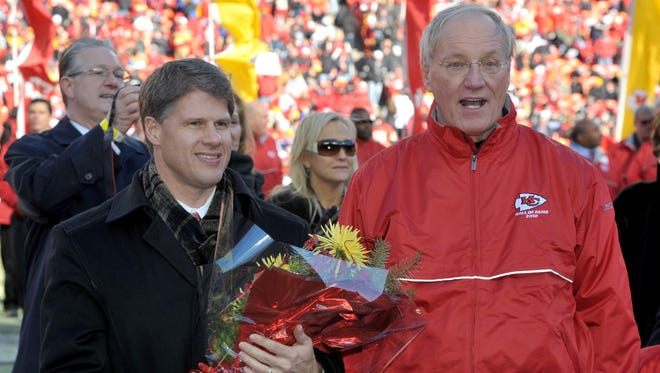 Former Kansas City Chiefs coach Marty Schottenheimer (right), shown in this 2011 photo, denied reports of a return to coaching.