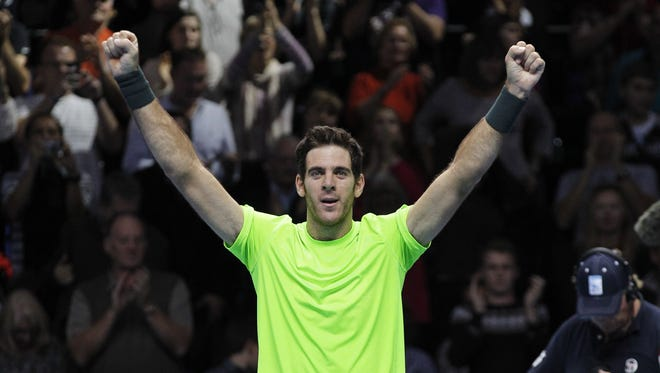Juan Martin del Potro of Argentina reacts to his win over Roger Federer of Switzerland at the end of their ATP World Tour Finals singles tennis match at the O2 Arena, in London.