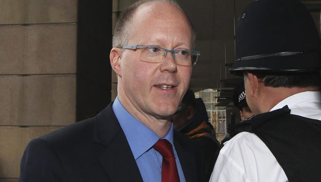 George Entwistle leaves Portcullis House in London after giving evidence to the Parliament Select Committee on Oct. 23.