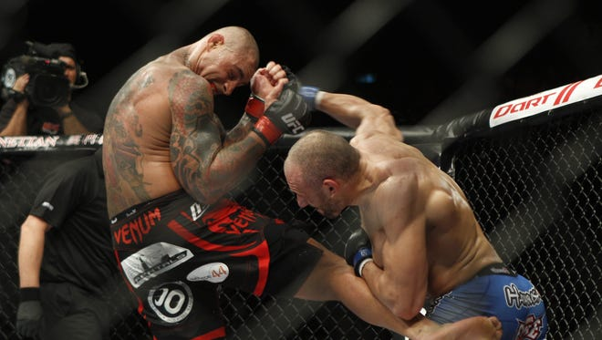 Thiago Silva , left, shown here during a light heavyweight match Nov. 7, won against Stanislav Nedkov. In the main event on Saturday, Cung Le defeated Rich Franklin.