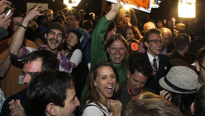 People attending a watch party at a Denver bar Tuesday night celebrate the announcement that Colorado voters had approved an amendment legalizing recreational use of marijuana.