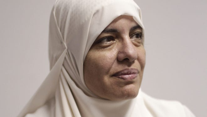 Azza el-Gharf,  a 47-year-old mother of seven and a member of the Muslim Brotherhood's Freedom and Justice Party, is interviewed at the party's office in Cairo.